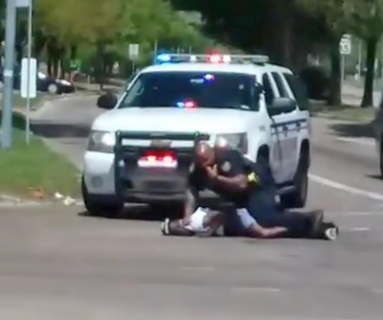 Image: Still image taken from a social media video shows Danny Ray Thomas on the ground next to a sheriff's deputy after he was shot, in Houston, Texas