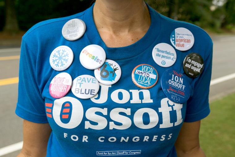 Image: Cherish Burnham of Roswell decorates her shirt with political buttons and shows her support of Democratic candidate Jon Ossoff