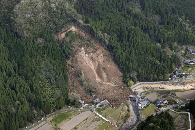 Image: A landslide early on April 11 buried homes and left six missing in Nakatsu, Japan