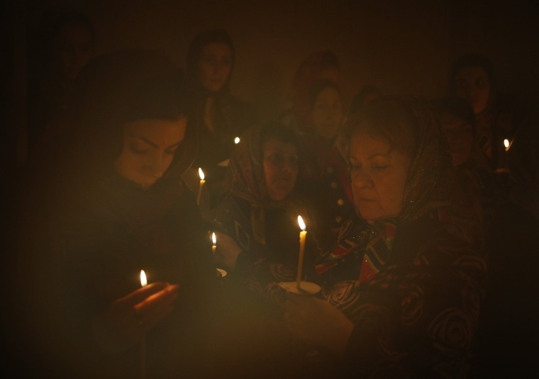 Image: Members of the Nekrasov Cossack community attend an orthodox service at the Church of the Assumption