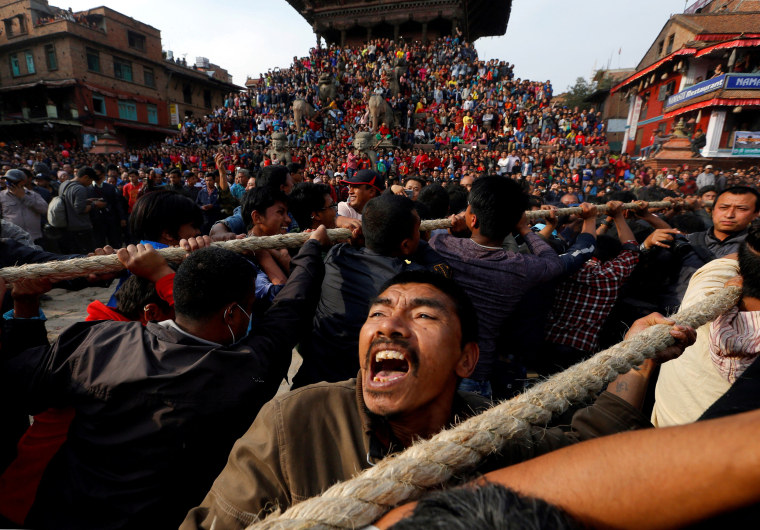 Image: Devotees pull the chariot of God Bhairab during the Biska Festival also known as Bisket Festival in Bhaktapur
