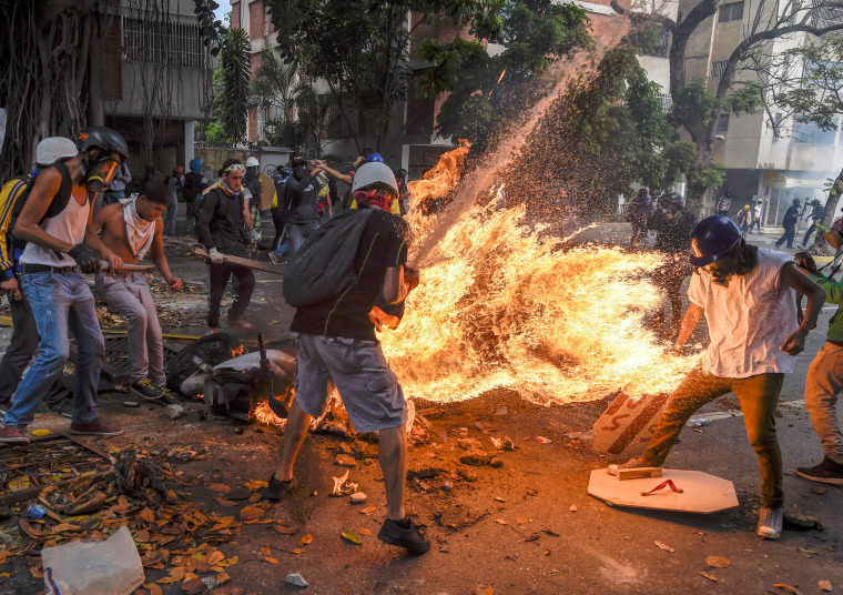 Image: Third-placed series of images of World Press Photo 2018 contest for Spot News Stories - Juan Barreto, Agence France-Presse - Demonstrator Catches Fire