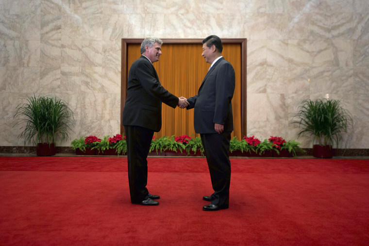 China's President Xi greets Cuba's First Vice President of the Council of State Diaz-Canel in Beijing