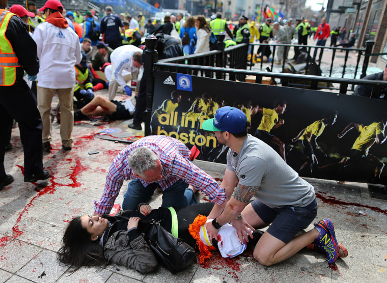 Image: Bystanders help an injured woman
