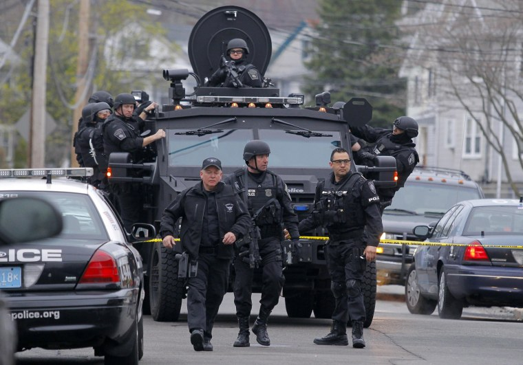Image: SWAT teams enter a suburban neighborhood to search an apartment for the remaining suspect in the Boston Marathon bombings in Watertown