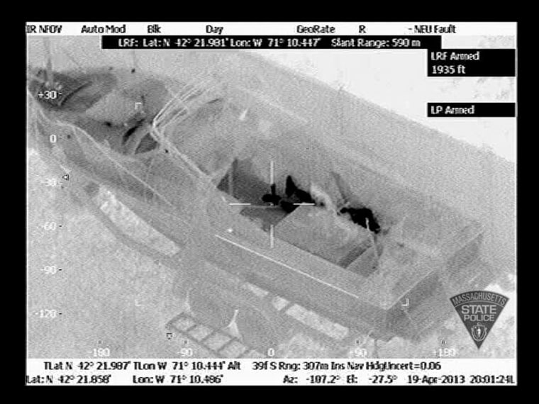 Image: Handout of an aerial infrared image showing the outline of Dzhokhar Tsarnaev in a boat