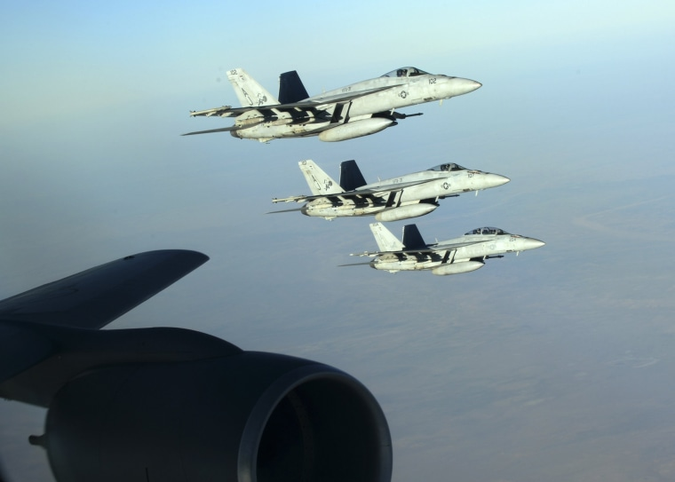 Image: A formation of U.S. Navy F-18E Super Hornets leaves after receiving fuel from a KC-135 Stratotanker over northern Iraq
