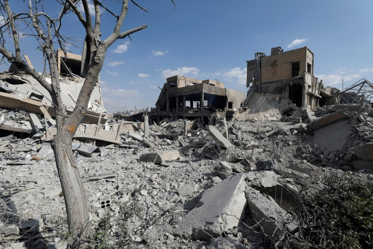 Image: The destroyed Scientific Research Centre is seen in Damascus