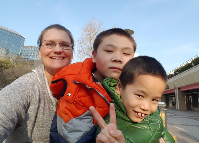 Kristi Smith with her sons Caleb, 9, and Ben, 14.