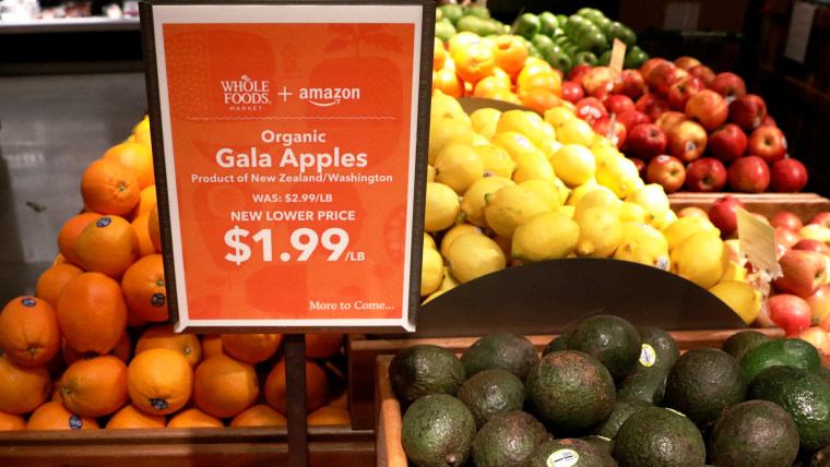 Image: Apples and Avocados are displayed at a Whole Foods store in New York