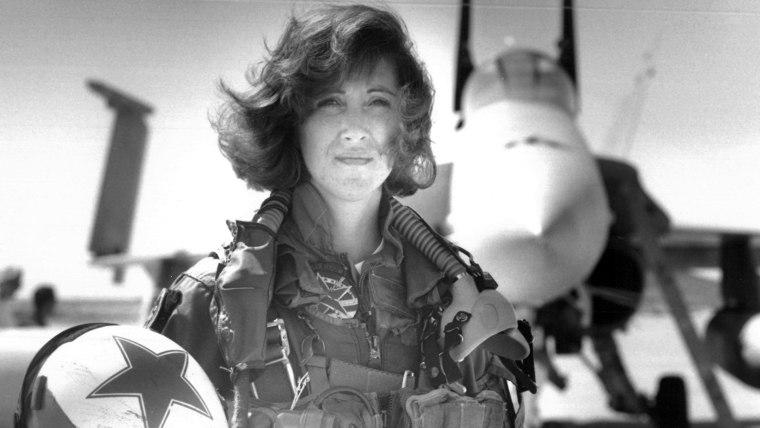 In this image provided by the U.S. Navy, Lt. Tammie Jo Shults, one of the first women to fly Navy tactical aircraft, poses in front of an F/A-18A with Tactical Electronics Warfare Squadron (VAQ) 34 in 1992. lts