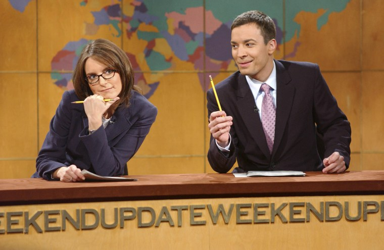 """SATURDAY NIGHT LIVE -- NBC Late Night -- Host: Eric McCormack -- Pictured: (l-r) """"Weekend Update"""" co-anchors Tina Fey and Jimmy Fallon. -- NBC Photo: Mary Ellen Matthews"""