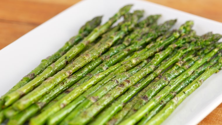 Grilled Asparagus on White Plate using Selective Focus