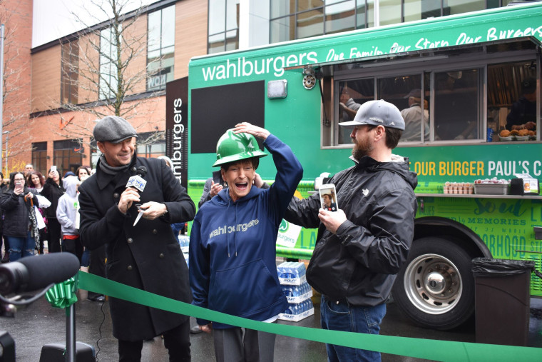 Members of the Wahlberg family cut the ribbon at their hometown food truck.