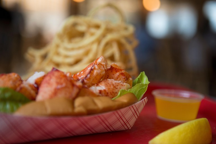 Cold lobster roll and onion rings at Arnold's Lobster and Clam Bar.