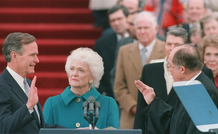 Image:  First lady Barbara Bush holds the bible for her husband George Bush as he is sworn into office