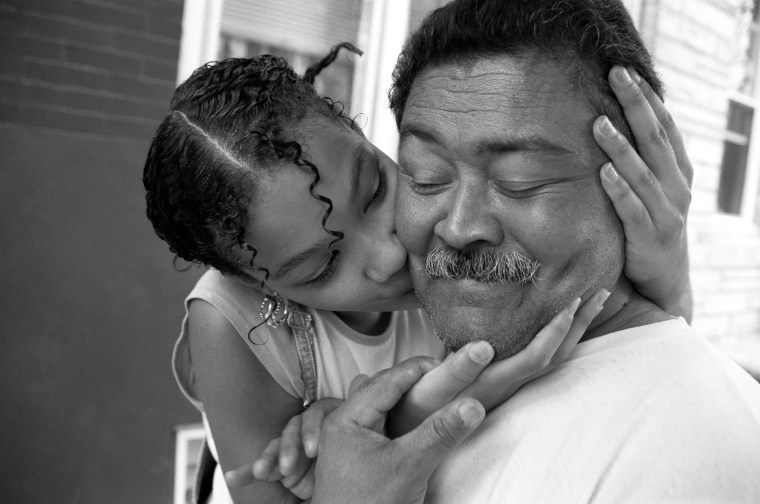 Karina kisses her abuelo after coming home from school