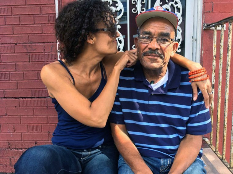 Image: Wanda Benvenutti sits with her father in front of her aunt's house in Philadelphia