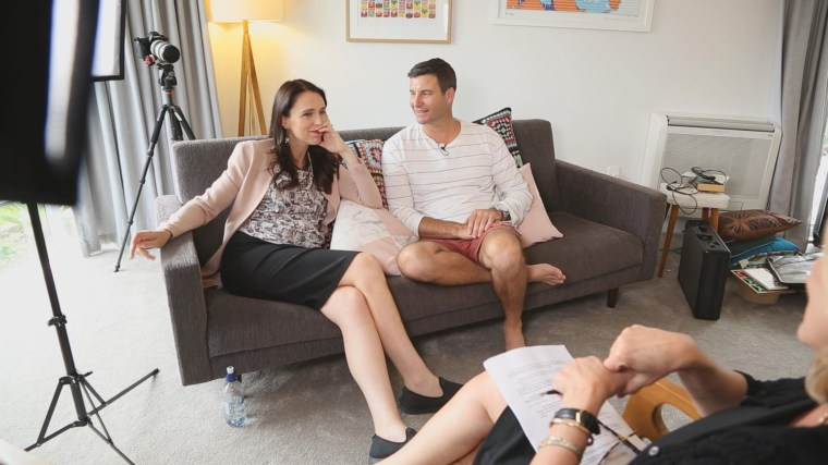 Prime Minister of New Zealand Jacinda Ardern sits with her partner, Clarke Gayford.