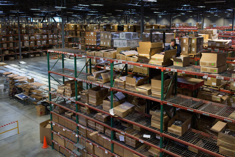 Image: An employee moves boxes at the Overstock.com Inc. fulfillment center in Salt Lake City