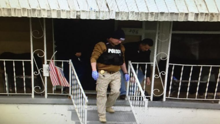 Image: Police during a raid in Huntington, West Virginia
