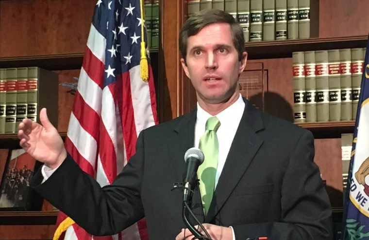 Image: Kentucky Attorney General Andy Beshear discusses a state Supreme Court ruling