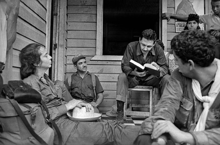 Raul Castro talks with a family of countrymen in Cuba,1964.