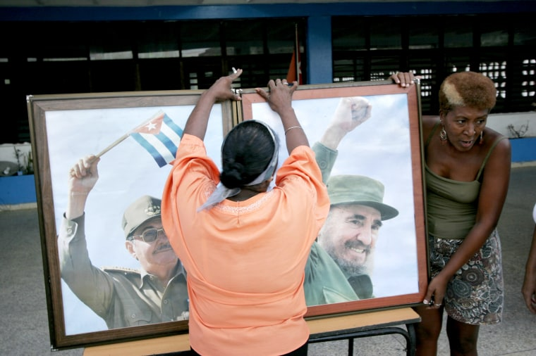 Communist Party members set up framed photographs of the Castros as they prepare for a political rally supporting Fidel Castro and the Revolution on Aug. 4, 2006 in Havana. Four days prior, Fidel temporarily handed power to his brother Raul while he recovered from intestinal surgery.