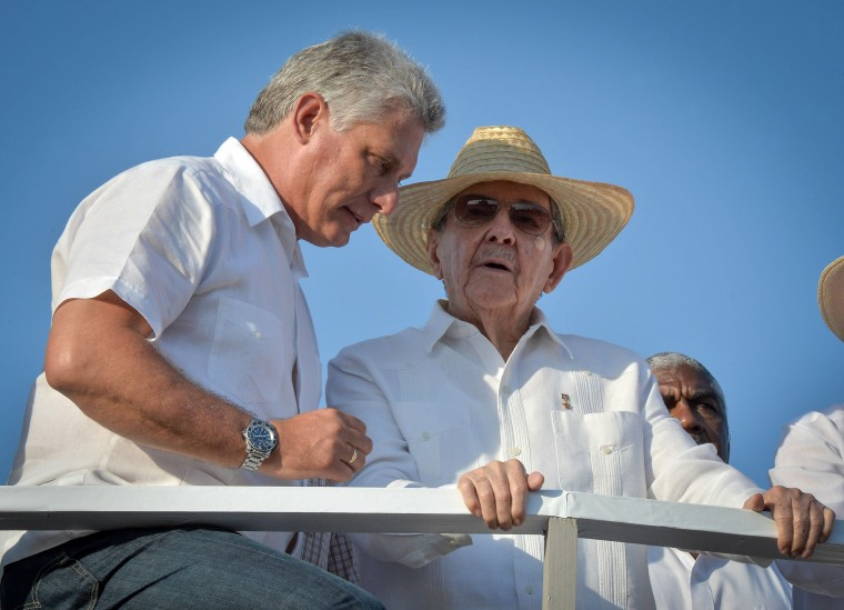 Cuban President Raul Castro and First Vice-President Miguel Diaz Canel attend the May Day parade at Revolution Square in Havana on May 1, 2016.
