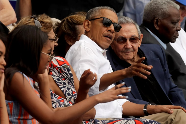U.S. President Barack Obama and Raul Castro visit during an exhibition game between the Cuban national team and the Major League Baseball team Tampa Bay Devil Rays at the Estado Latinoamericano in Havana, on March 22, 2016. It was the first time a sitting president visited Cuba in 88 years.