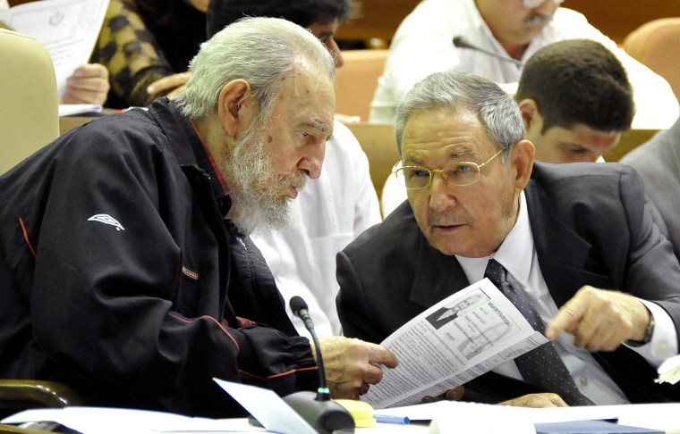 Fidel Castro and his brother talk during the opening session of the National Assembly in Havana, Feb. 24, 2012. Cuban President Raul Castro accepted a new five-year term that will be, he said, his last and tapped rising star Miguel Diaz-Canel, 52, as vice president and first in the line of succession. Diaz-Canel has risen higher than any other Cuban official who didn't directly participate in the 1959 Cuban revolution.