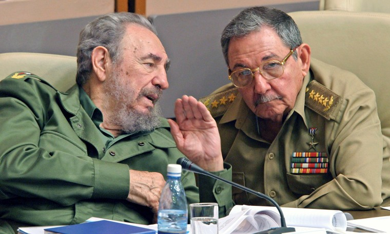Then-President Fidel Castro and his brother Raul at the Cuban Parliament, Dec. 23, 2003. It was announced on Feb. 19, 2008 that Fidel Castro resigned as Cuba's president, ceding power to his brother.