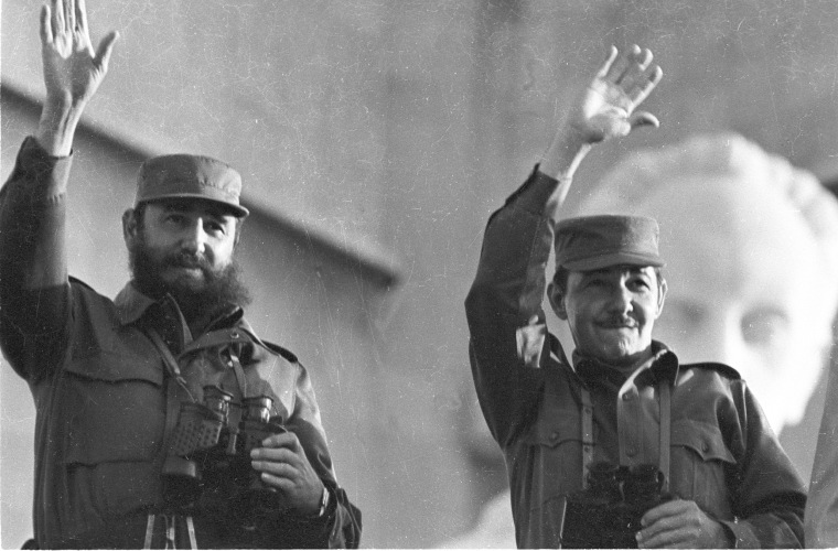 Fidel Castro and his brother Raul wave during the annual May Day parade in Revolution Plaza in Havana, May 1, 1973.
