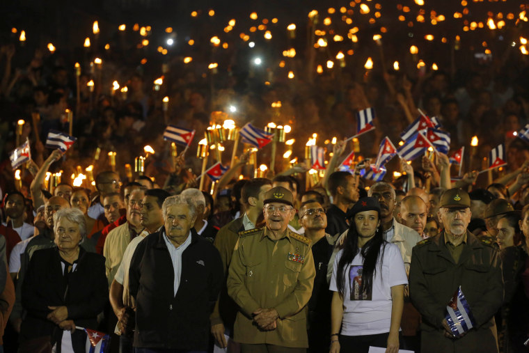 Cuba's President Raul Castro along with Uruguay's former President Jose Mujica, his wife Sen. Lucia Topolansky, President of University Students Federation Jennifer Bello and Revolutionionary Commander Ramiro Valdes,take part in a march with torches to mark the 163rd anniversary of the birth of Cuba's national independence hero Jose Marti, in Havana, Jan. 27, 2016.