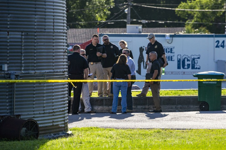 Image: Police gather across the street from Ace China in Trenton where they are investigating a shooting in Trenton, Florida, April 19, 2018.
