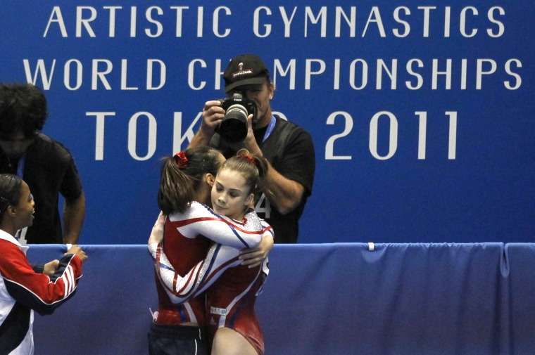 McKayla Maroney of the U.S. hugs a teammate after her competition on the floor during the women's team final at the Artistic Gymnastics World Championships in