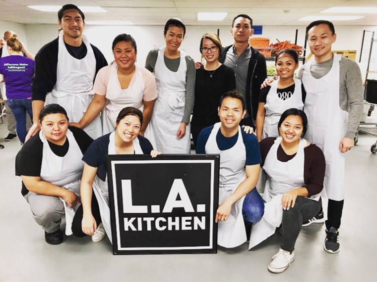 Image: Kulap Vilaysack with Laos Angeles members prepping meals for The L.A. Kitchen.