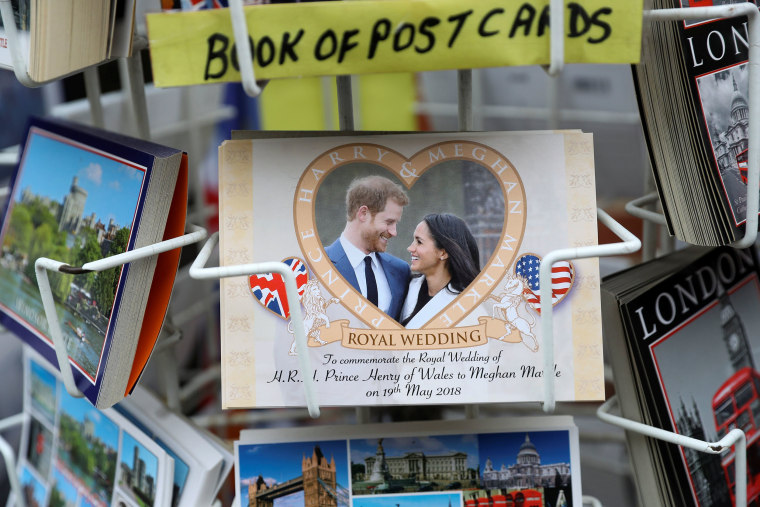 Image: Souvenirs featuring Britain's Prince Harry and his fiancee Meghan Markle sit on display in a shop near Windsor Castle in Windsor
