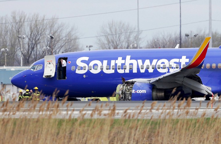 Image: A Southwest Airlines plane sits on the runway at the Philadelphia International Airport after it made an emergency landing in Philadelphia on April 17, 2018.