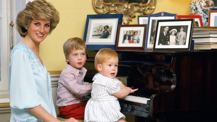 Diana, Princess of Wales with her sons, Prince William and Prince Harry, at the piano in Kensington Palace in 1985.