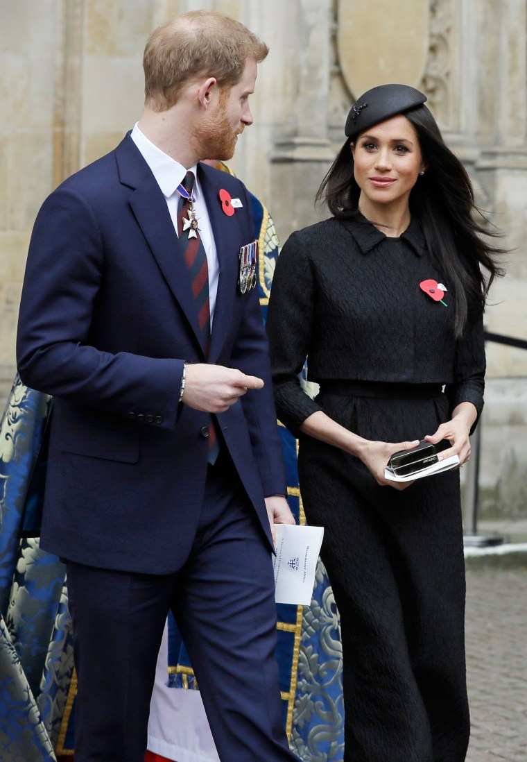 Britain's Prince Harry (L) and his US fiancee Meghan Markle leave after attending a service of commemoration and thanksgiving to mark Anzac Day in Westminster Abbey in London on April 25, 2018.