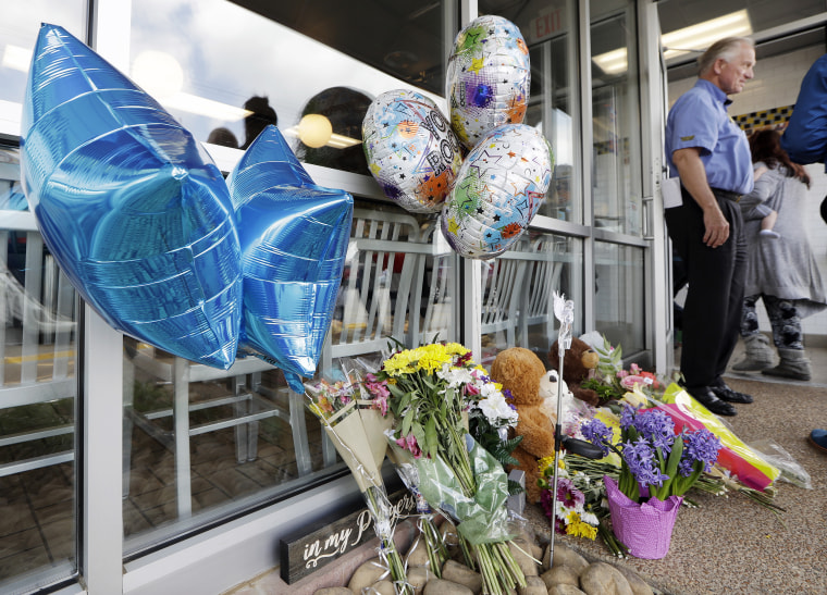 Flowers, balloons, and stuffed animals make up a makeshift memorial at the door to the Waffle House restaurant Wednesday, April 25, 2018, in Nashville, Tenn. The restaurant re-opened Wednesday after four people were killed by a gunman Sunday.