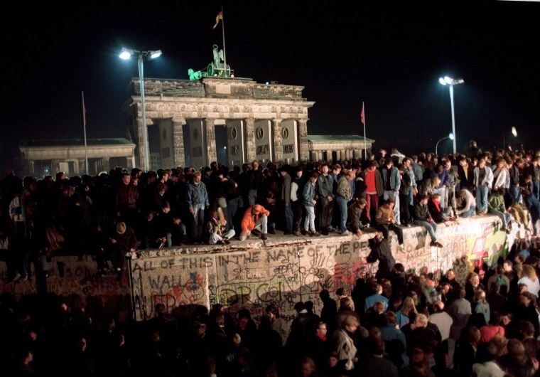 Thousands of young East Berliners crowd atop the B