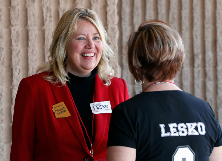 Image: Debbie Lesko speaks with a constituent