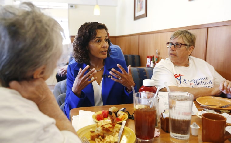 Image: Dr. Hiral Tipirneni speaks with supporters