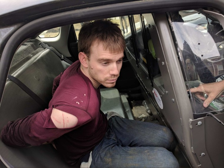Image: Travis Reinking apprehended in a wooded area in Nashville, Tennessee on Monday, April 23, 2018.