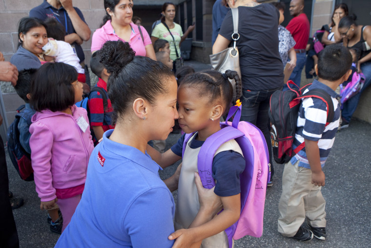 Image: A mom drops off her daughter on her first day of kindergarten