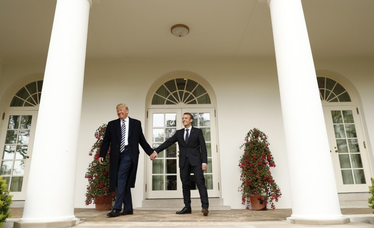 Image: U.S. President Trump welcomes French President Macron during arrival ceremony at the White House in Washington