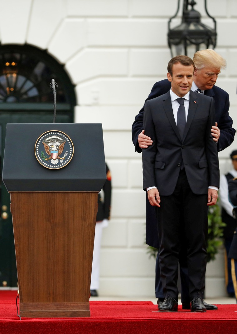 Image: U.S. President Donald Trump and first lady Melania Trump welcome French President Emmanuel Macron and his wife Brigitte Macron during an arrival ceremony at the White House in Washington