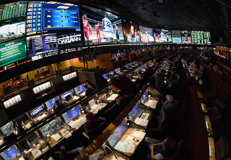 Image: Guests watch the NCAA college basketball tournament at the Westgate Superbook sports book